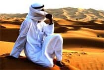 A bedouin man on a sand dune