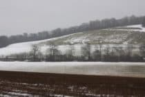 Snow thawing on a hill