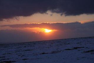 Snow on the south downs at dusk